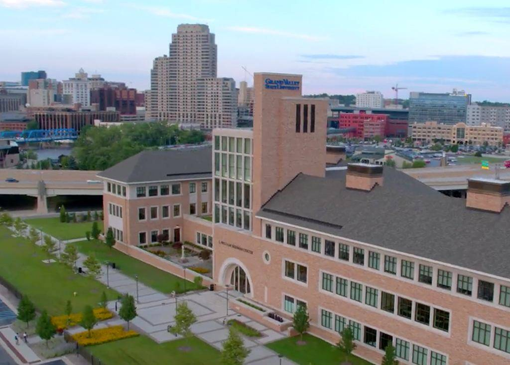 The exterior of Seidman with the city of Grand Rapids in the background.